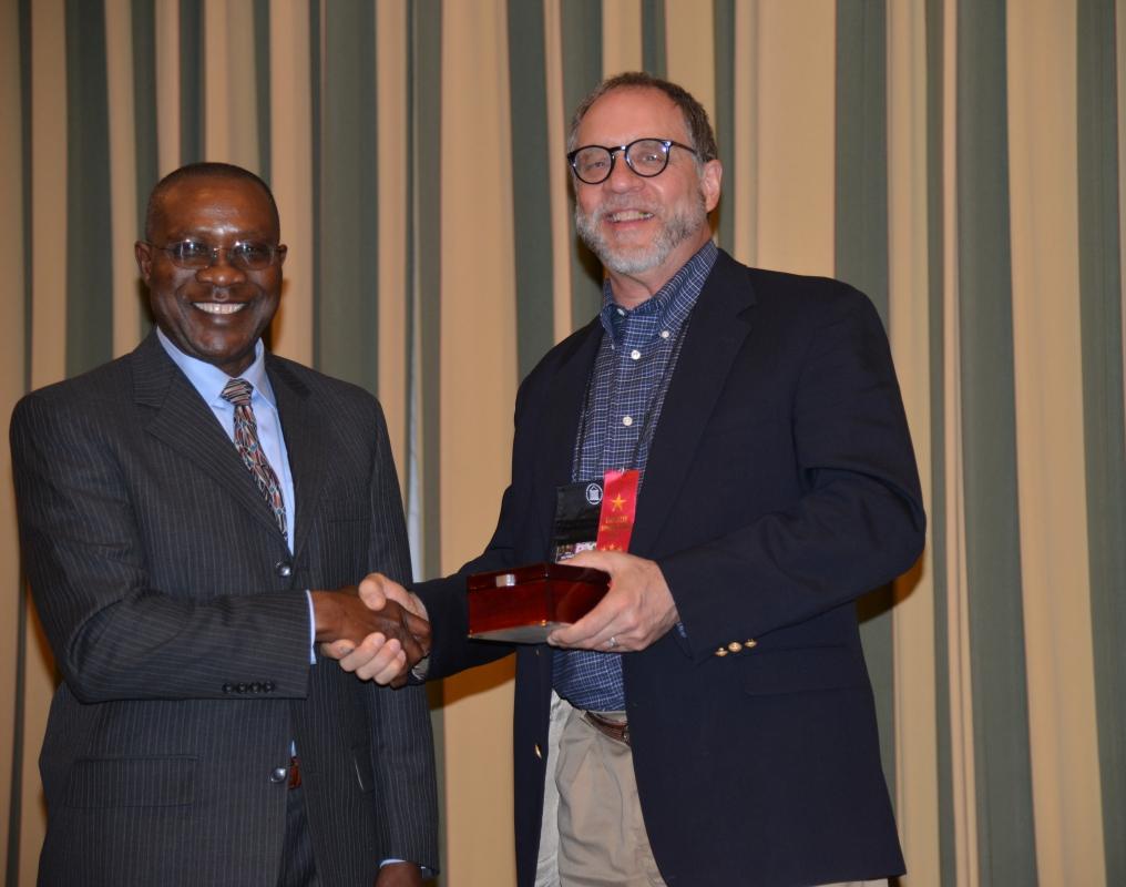 Hyacinth Ide receiving Regents Distinguished Service Award